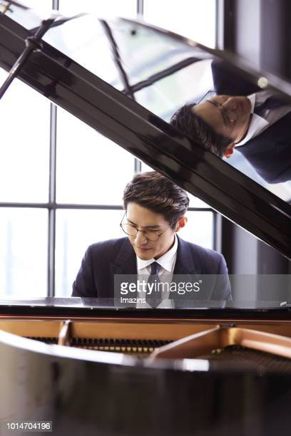 businessman playing piano - pianist front stock pictures, royalty-free photos & images