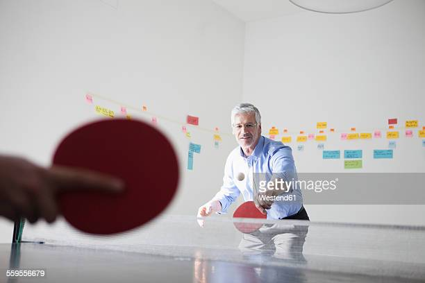 Businessman playing table tennis