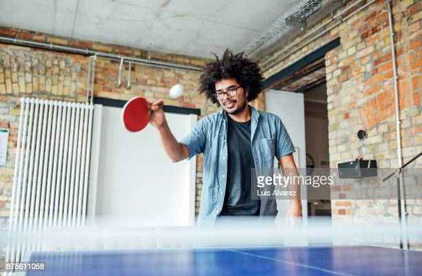 businessman playing table tennis - table tennis stock pictures, royalty-free photos & images
