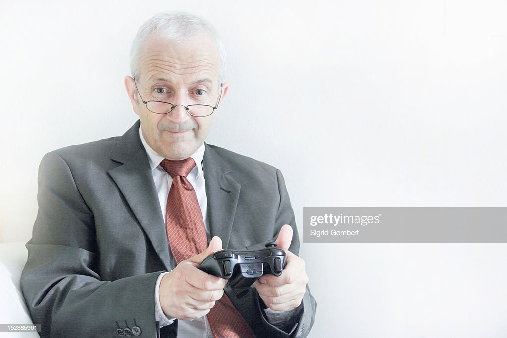 Businessman playing video games : Stock-Foto