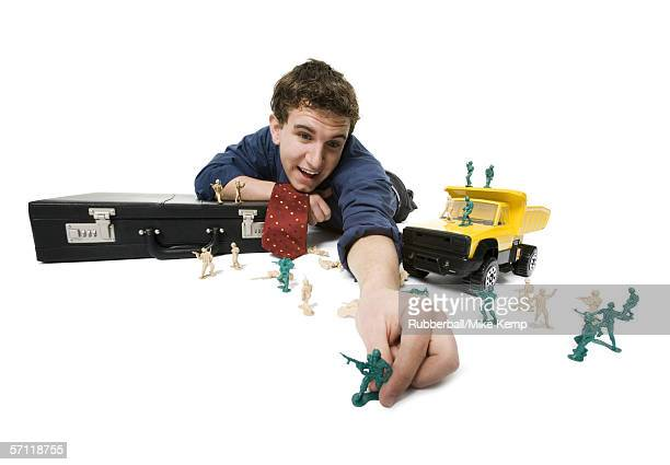 Businessman playing with toys