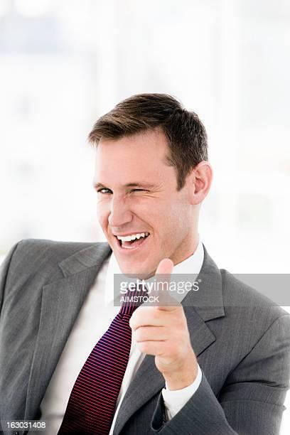 Businessman pointing at camera