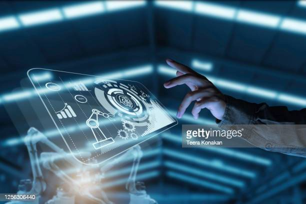 businessman pointing at hologram with icon on virtual screen, smart factory technology interface - inteligência imagens e fotografias de stock