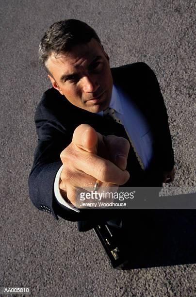 businessman pointing finger - weitwinkel stock-fotos und bilder