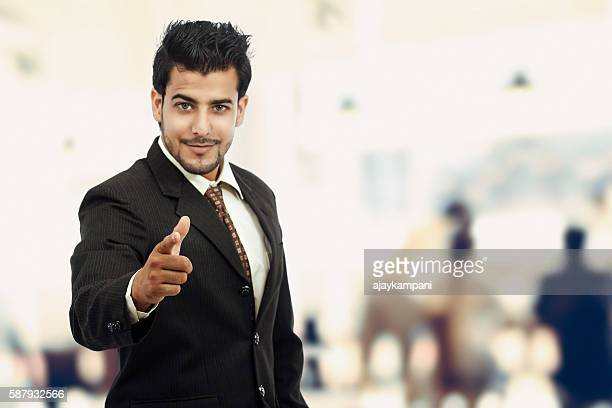 Businessman pointing his finger at you