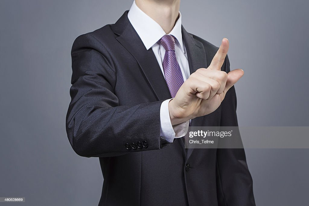 Businessman pointing his finger : Stockfoto
