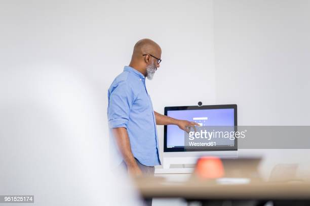 Businessman pointing on computer screen