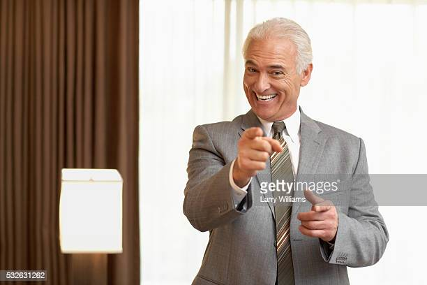 businessman pointing - salesman stock pictures, royalty-free photos & images