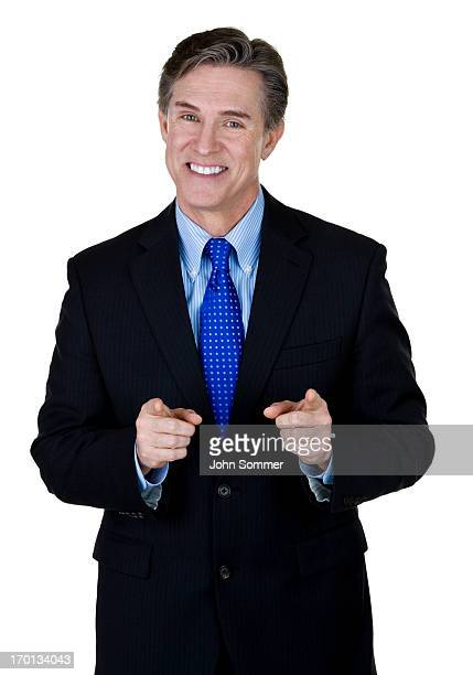 Businessman pointing to viewer
