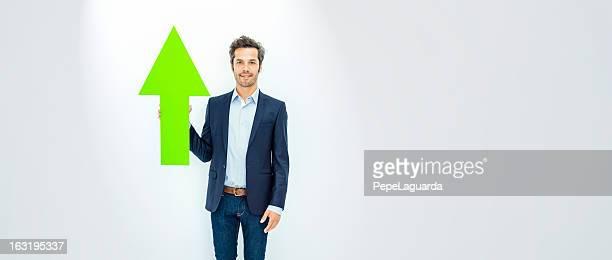 ビジネスマンを指す矢印、緑色