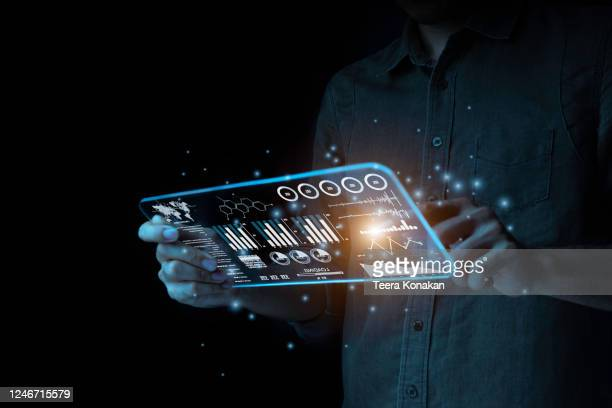 a businessman points to a hologram on his smartphone to analyze and find ways to plan his fast growing business on the black background. new generation technology concept - digital viewfinder stock pictures, royalty-free photos & images