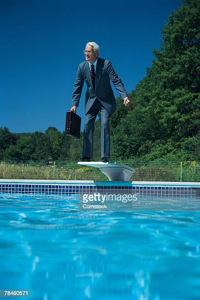 Businessman poised on diving board