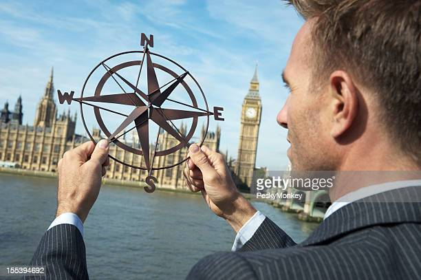 Businessman Politician MP Holds Compass at Houses of Parliament London