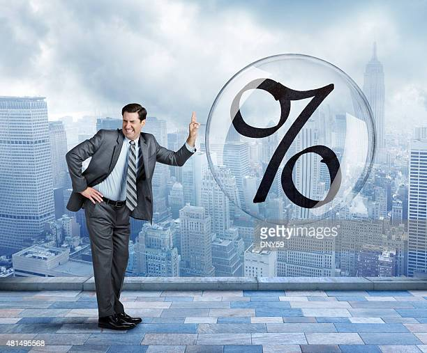 Businessman Popping Interest Rate Bubble