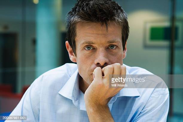 businessman, portrait, close-up - hand on chin stock pictures, royalty-free photos & images
