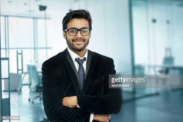 businessman portrait. happy confident young businessman standing arms crossed, smiling. - india stock pictures, royalty-free photos & images