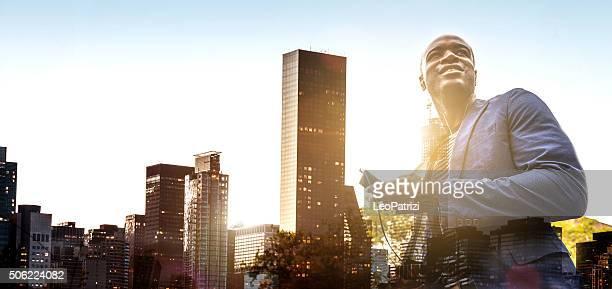 Businessman portrait in front skyline