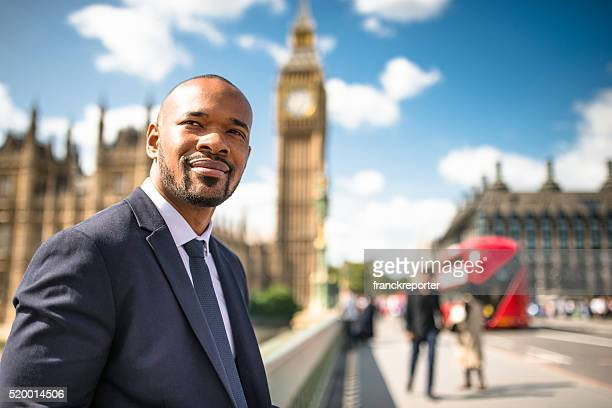 businessman portrait in london - houses of parliament london stock photos and pictures