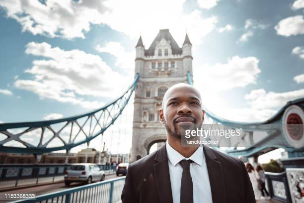 businessman portrait on tower bridge london - politician stock pictures, royalty-free photos & images