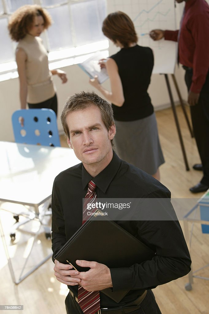 Businessman posing at workplace : Stockfoto