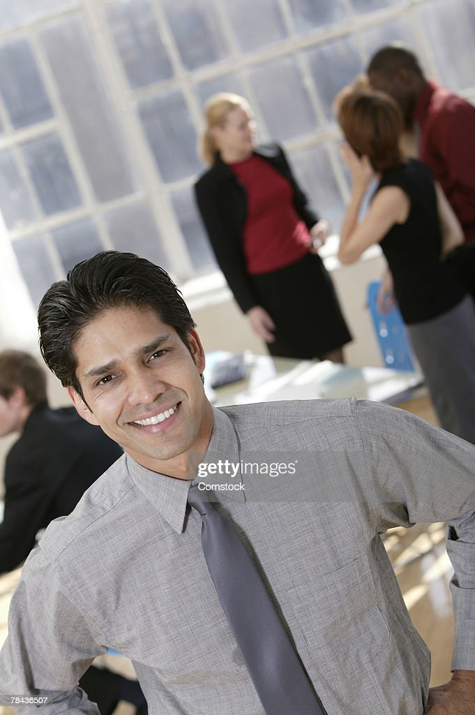Businessman posing in workplace : Stockfoto
