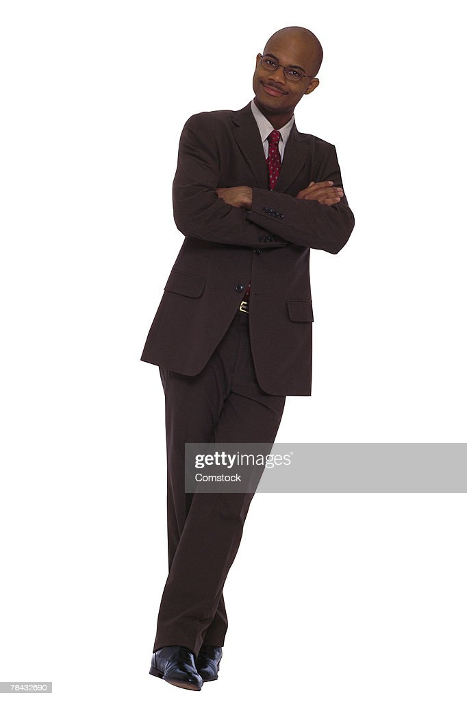 Businessman posing with arms folded : Stock Photo