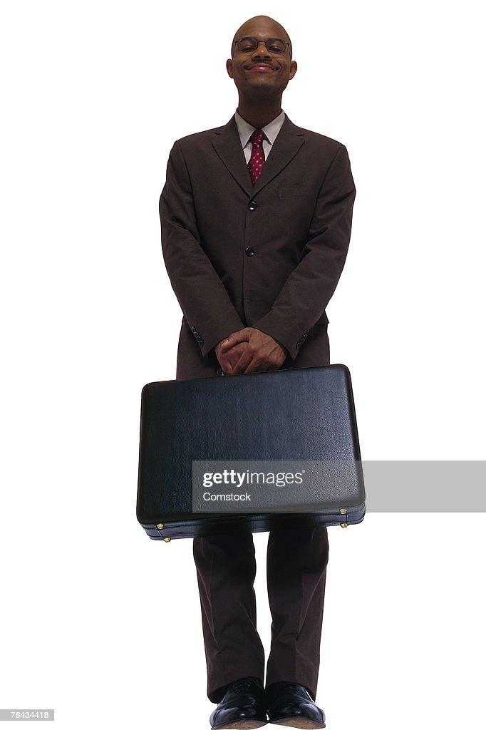 Businessman posing with briefcase : Foto de stock