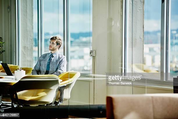 Businessman preparing for meeting in office
