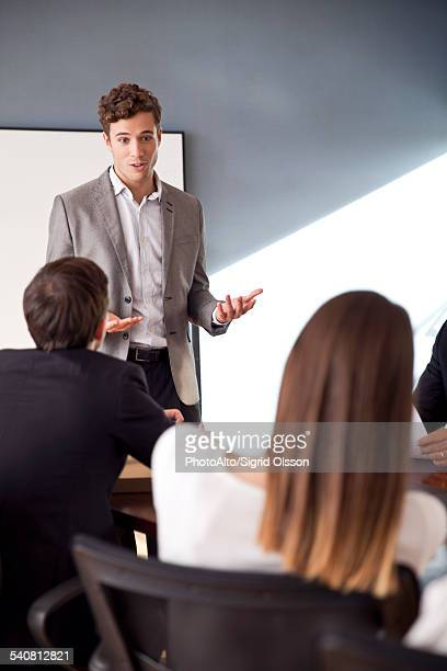Businessman presenting at business meeting