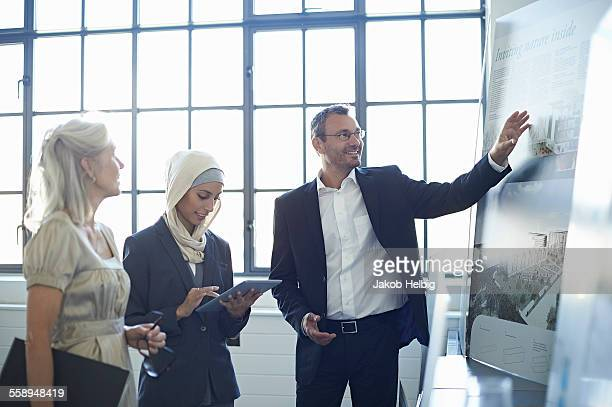 Businessman presenting ideas to business team in office