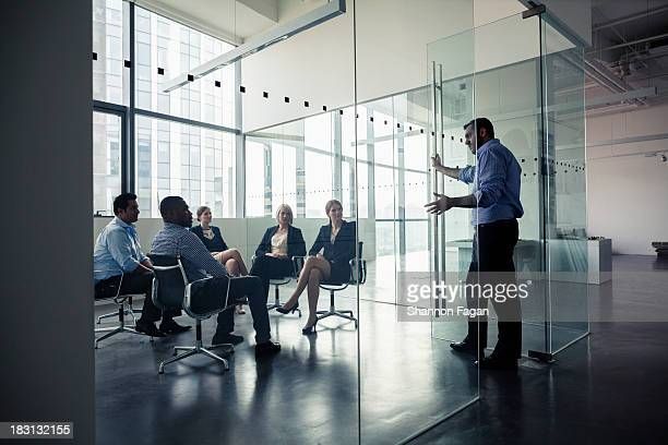 Businessman presenting in front of a group