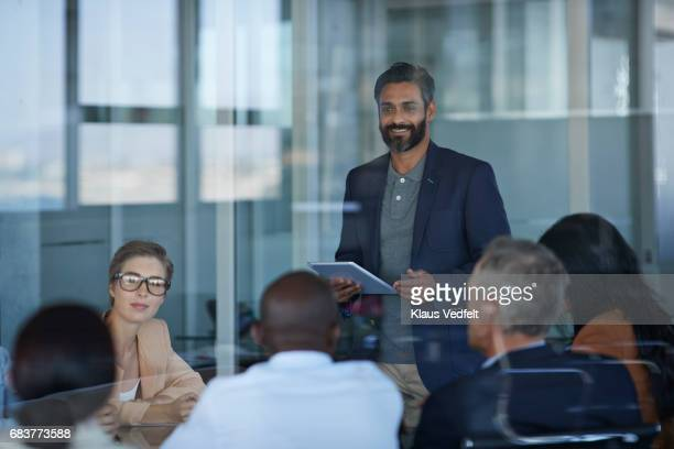 Businessman presenting project in meeting room