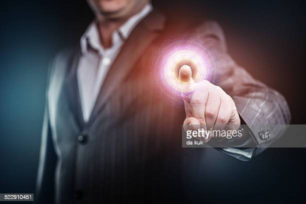 businessman pressing a futuristic button - hud graphical user interface stock photos and pictures