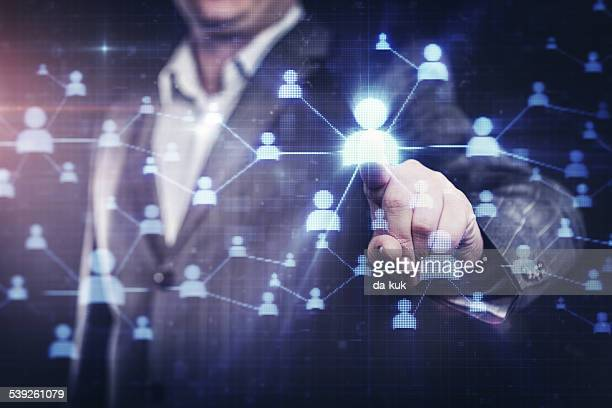 businessman pressing social network button on modern digital display - hud graphical user interface stock photos and pictures