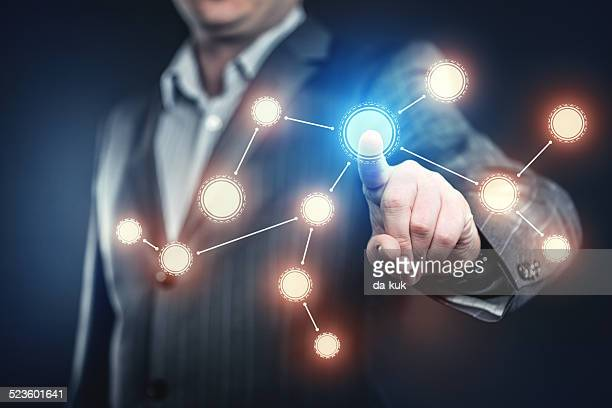 businessman pressing social network button - hud graphical user interface stock photos and pictures