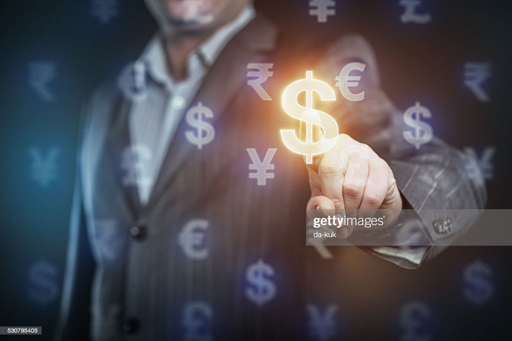 Businessman pressing US dollar symbol : Stock Photo