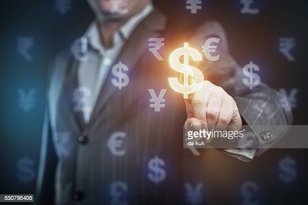 businessman pressing us dollar symbol - hud graphical user interface stock photos and pictures