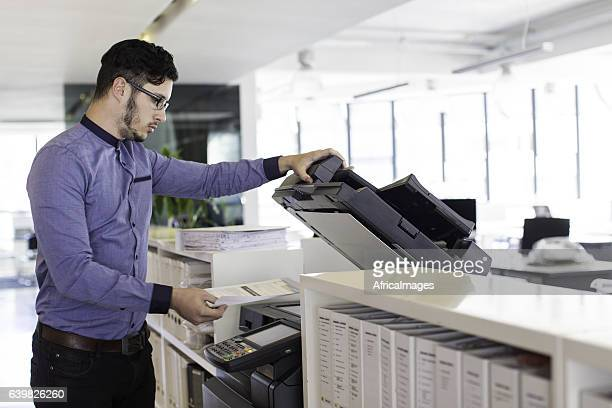 Businessman printing in the office.