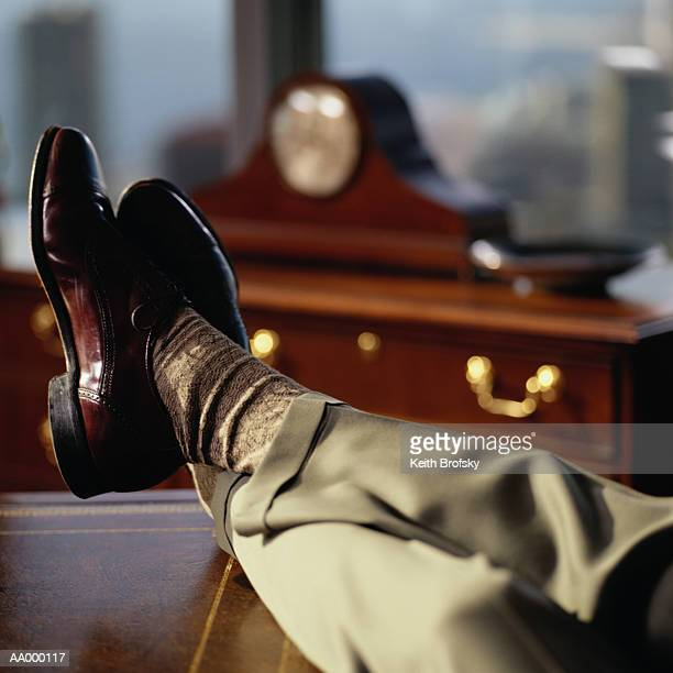 businessman propping his feet on his desk - legs crossed at ankle stock pictures, royalty-free photos & images