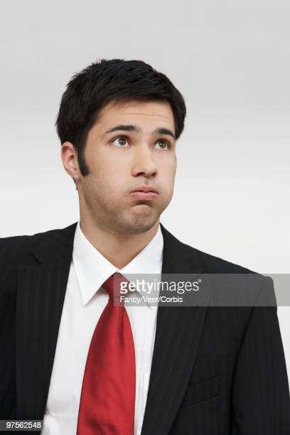 Businessman Puffing Cheeks