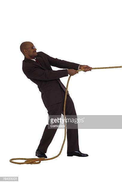 Businessman pulling on rope
