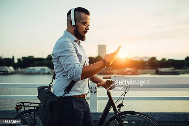 Businessman Push Bicycle and Using Smartphone Outdoors.