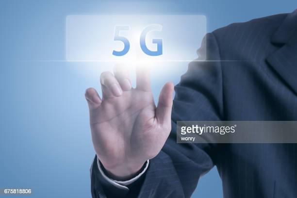 Businessman pushing 5G icon