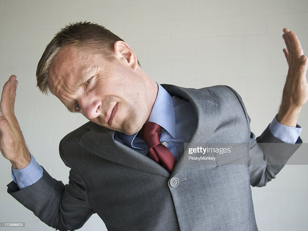 Businessman Pushing Against the Walls of His Box Frame : Stock Photo