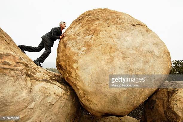 Businessman Pushing Boulder