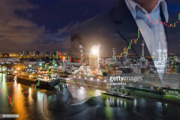 Businessman pushing icon of Stock market chart. Marketing concept. oil refinery industry plant from aerial view in oil refinery industry or oil industrial. This oil refinery is in the city for refinery producing of oil and gasoline. Industrial concept.