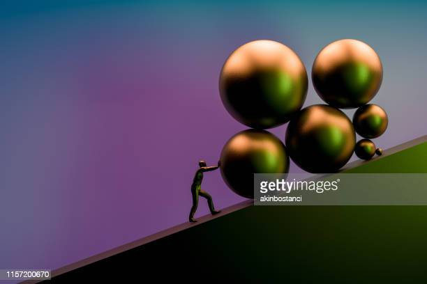businessman pushing large stone uphill - surreal stock pictures, royalty-free photos & images