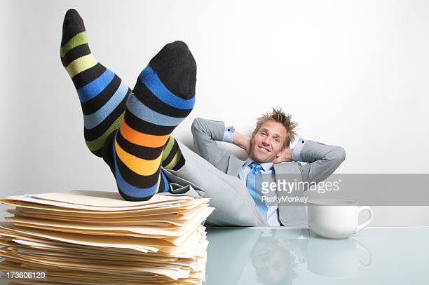 Businessman Puts His Feet Up