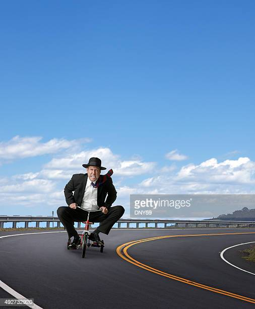 Businessman Racing On A Tricycle