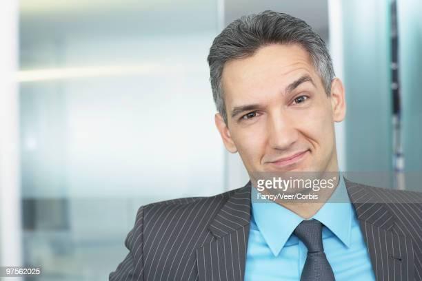 Businessman raising eyebrow